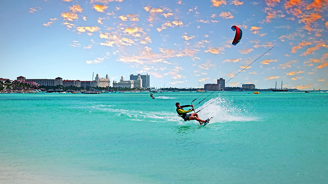 Kitesurfing adventures above aqua seas