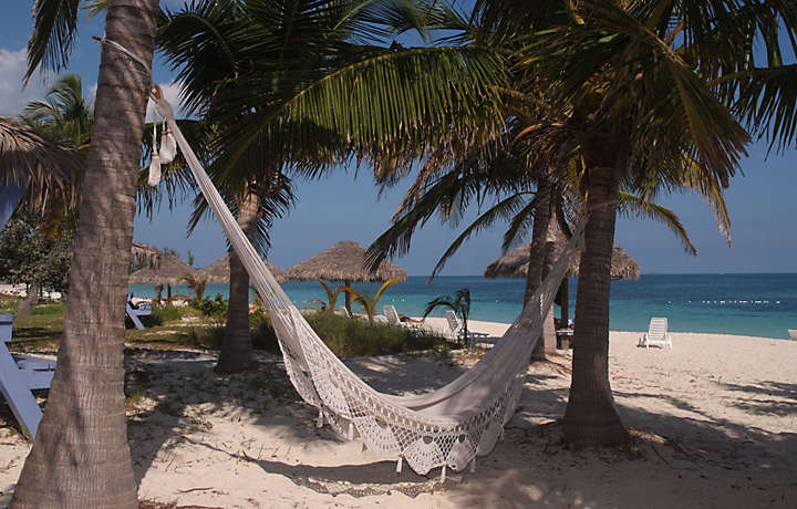 Relax in a hammock in the Bahamas