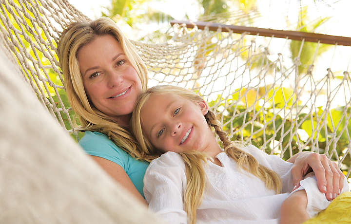 Mother and Daughter on Hammock - Solara Surfside™