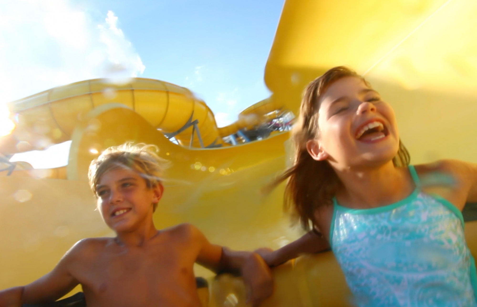 Kids sliding down water slide