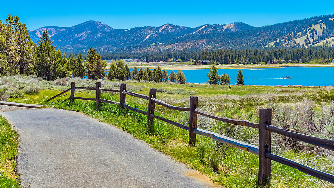 Take the scenic trail as it skirts a valley lake