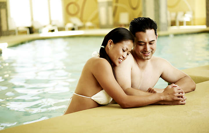 Couple in Pool - Bluegreen Club 36™