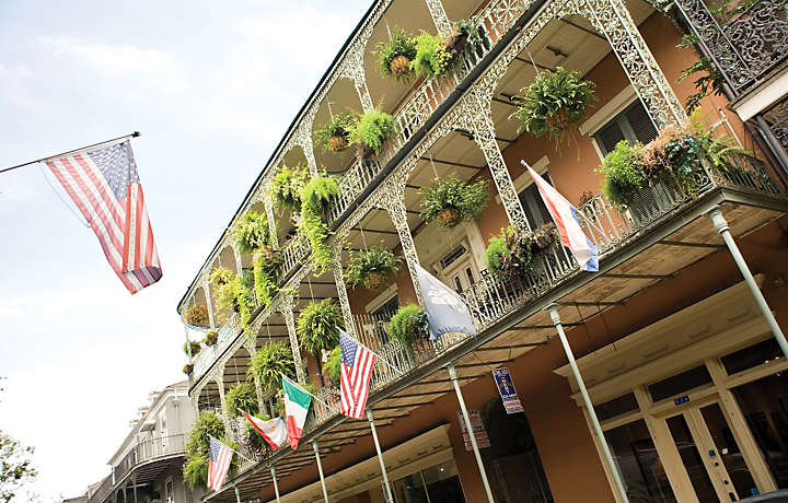 Balconies with flowers and flags in Louisiana