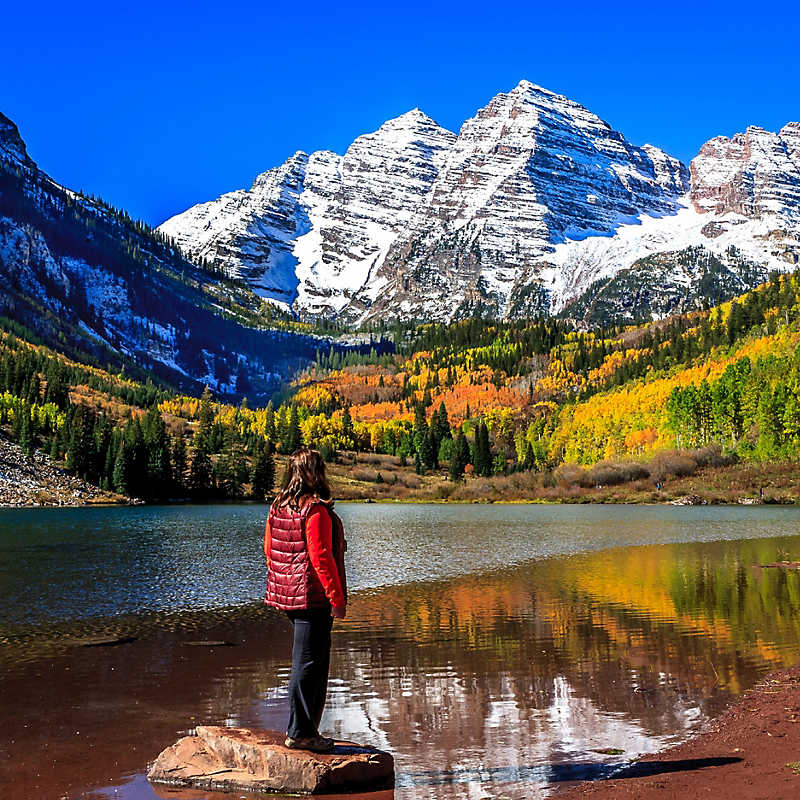 Woman admiring the lake view at Maroon Bells Mountains