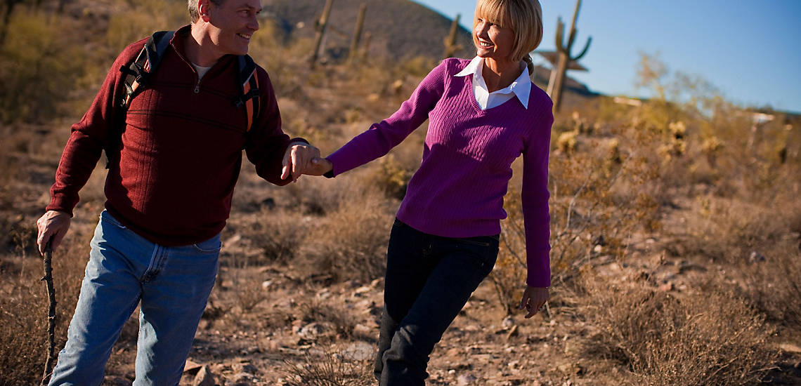 couple walking in the desert