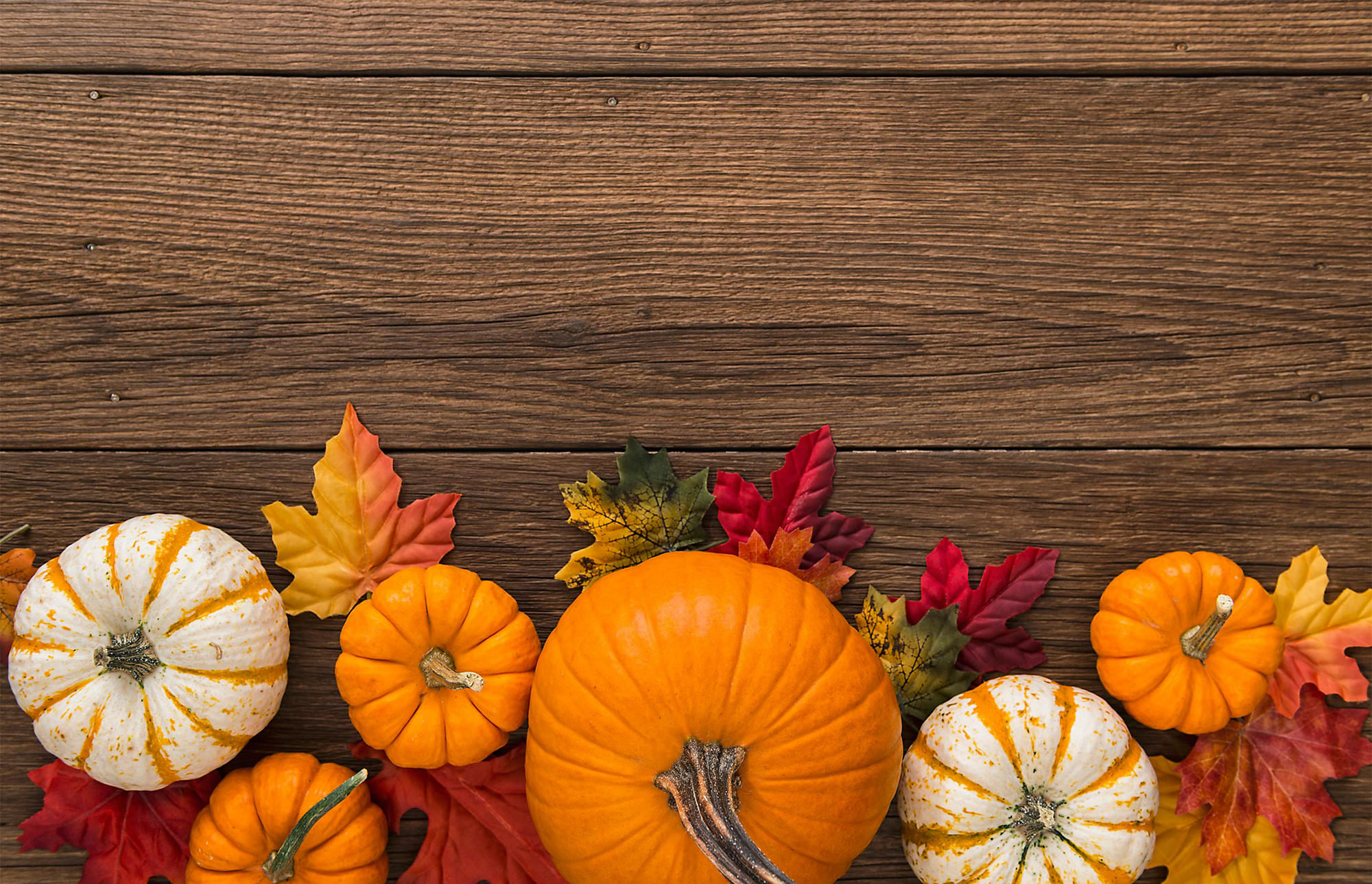 Fall Autumn leaves with pumpkins on desktop