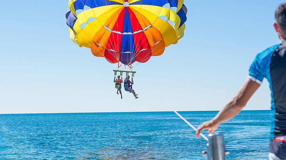 Parasailing over endless blue waters