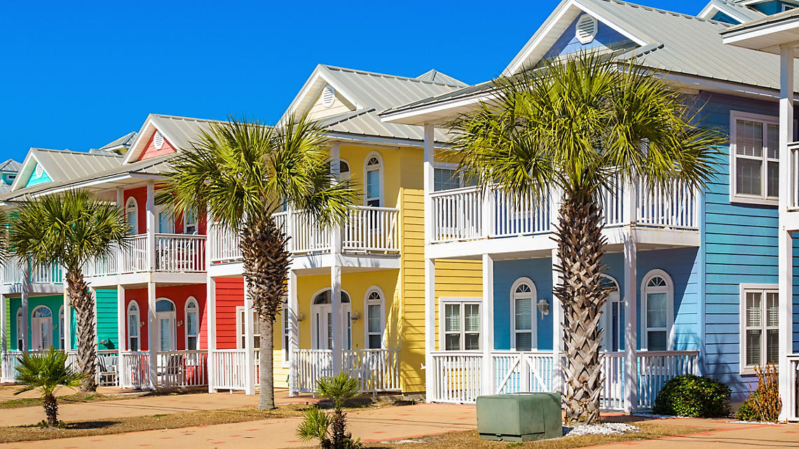 Quaint and colorful houses line the shore.