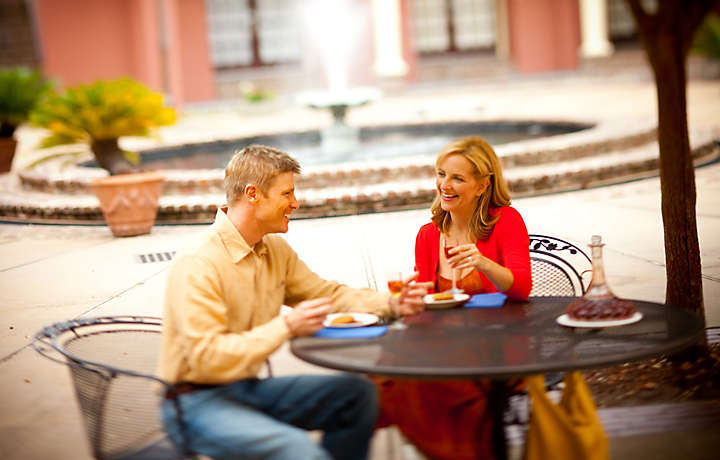 Couple in Courtyard - The Lodge Alley Inn™