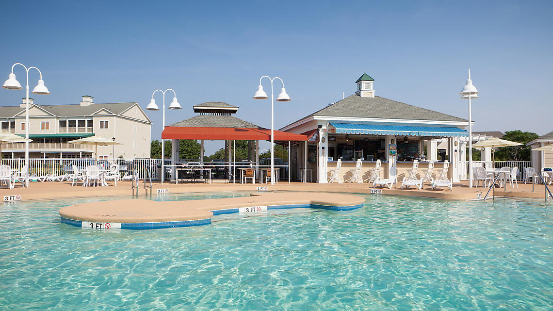 Outdoor Resort Pool And Poolside Bar