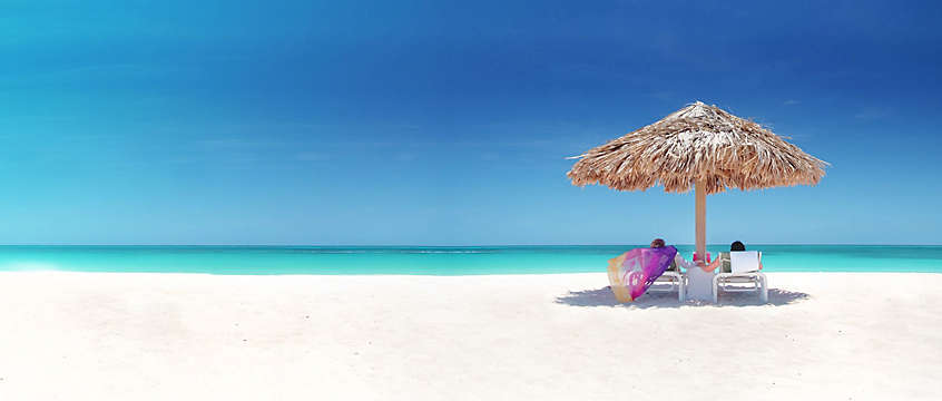 Island - Aruba, couple on the white sand beach