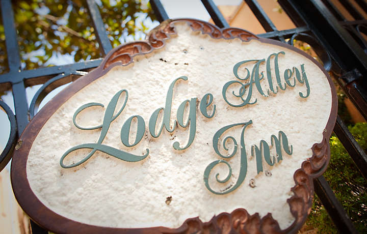 Sign on Gate - The Lodge Alley Inn™