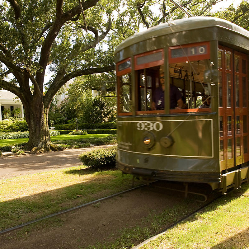 People on green trolley while on Garden District Tour