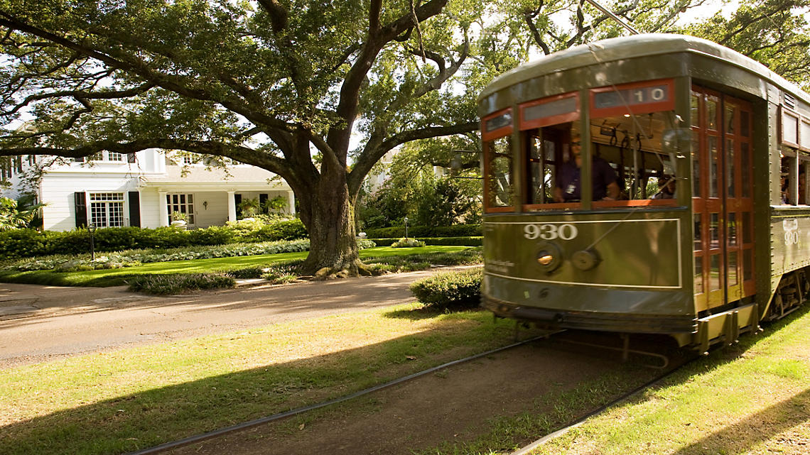 Ride the historic St Charles streetcar on a tour of New Orleans