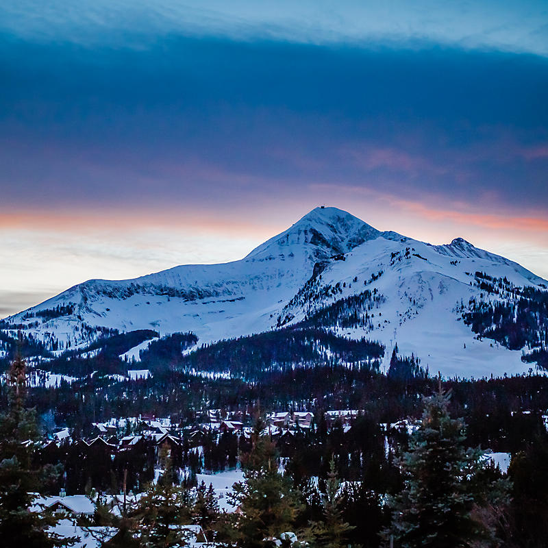 Sunset and snowy mountain range at Lone Peak Expedition, Montana