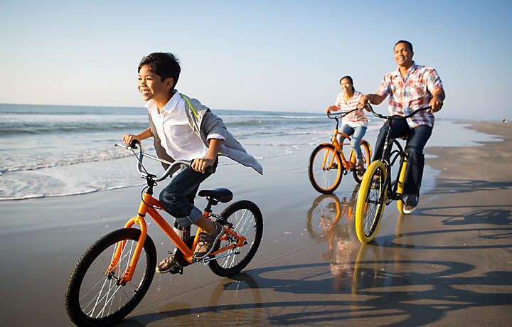 Family Bike Riding on Beach - Shore Crest Vacation Villas™ I & II