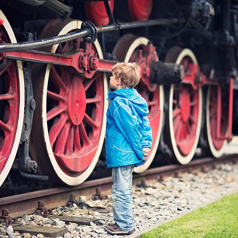 boy staring at a steam locomotive