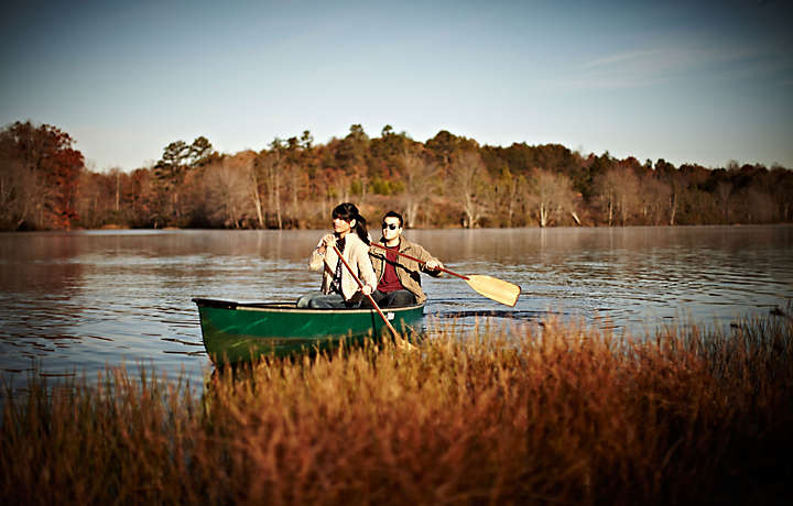 Couple canoeing on the lake in Georgia