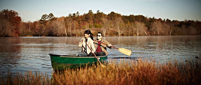 Lake vacation - couple in a canoe