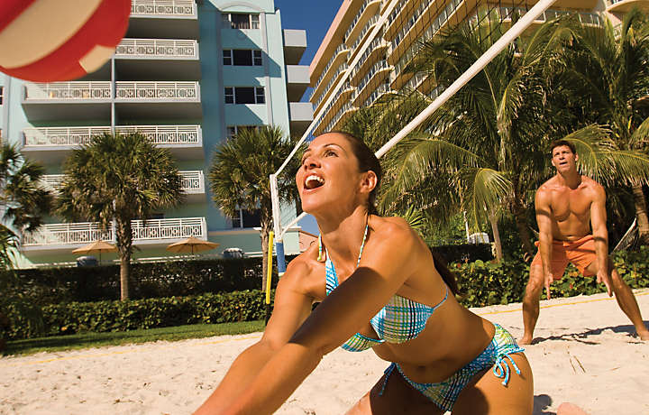 Couple Playing Volleyball - Solara Surfside™