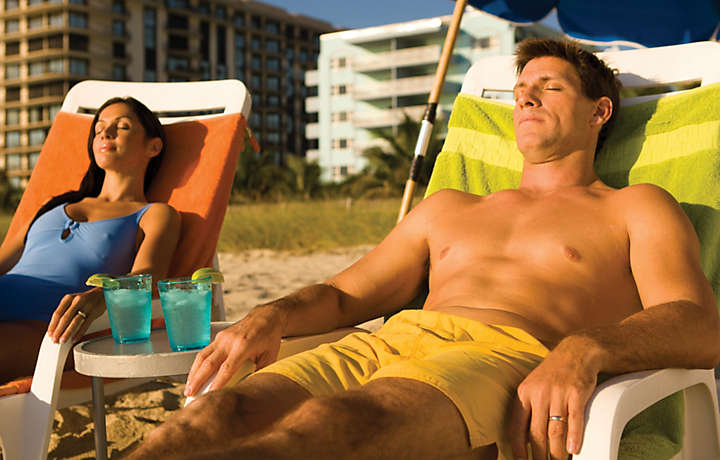 Couple on Beach Chairs - Solara Surfside™
