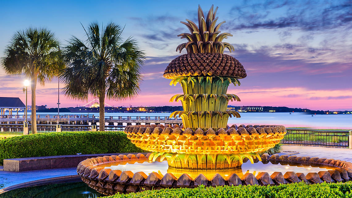 Dusk falls on the Pineapple Fountain in Waterfront Park