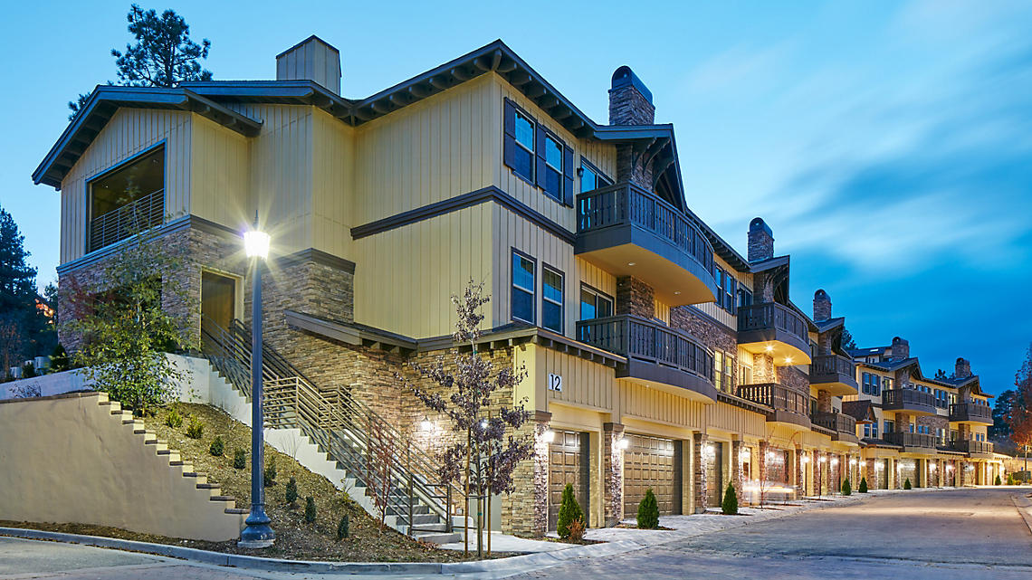 The Club at Big Bear Village townhomes at dusk
