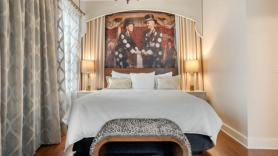 Take center stage with AR technology on the Master bedroom headboard of the Presidential Suite.