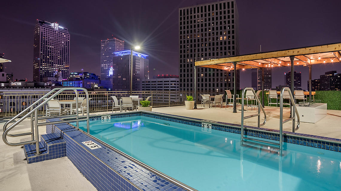 Enjoy a short swim surrounded by city lights in the rooftop pool.