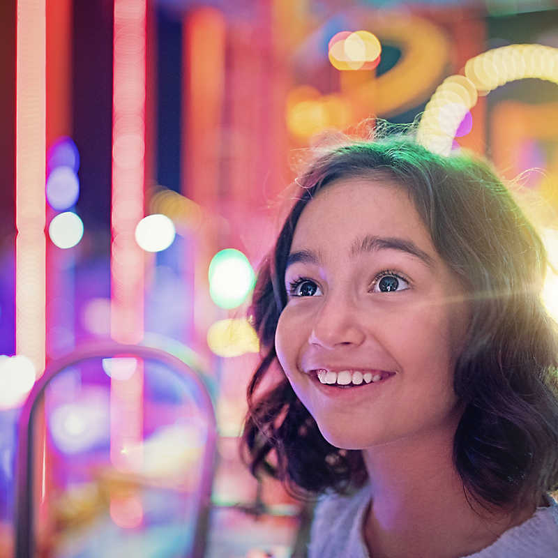 Girl close-up in an arcade