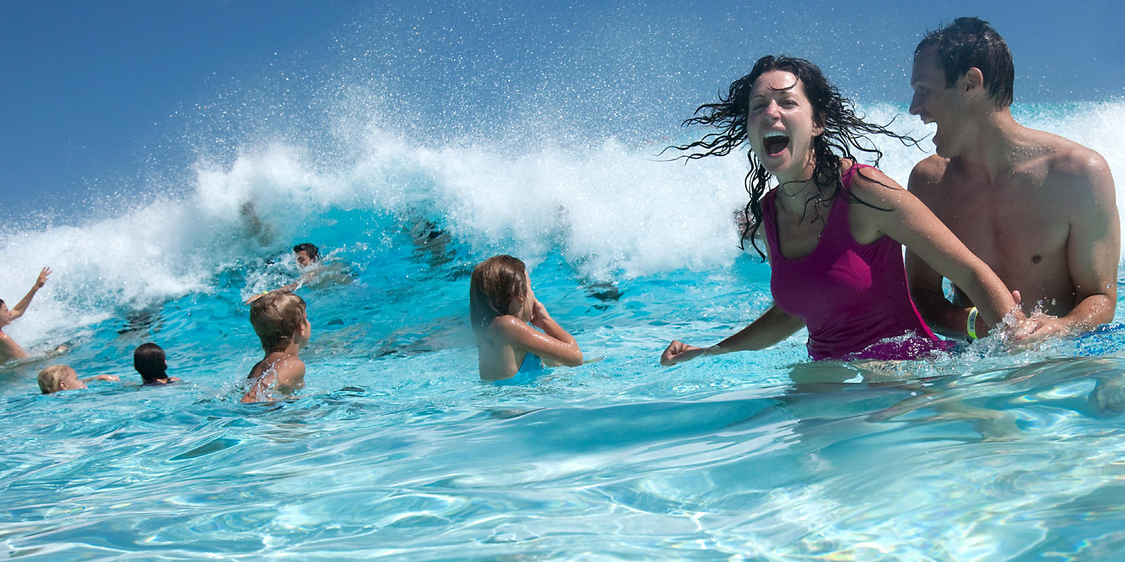 Couple and kids in wave pool
