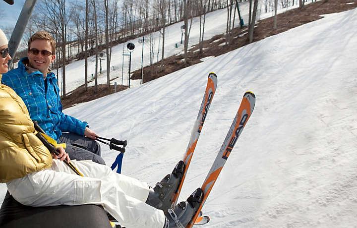 Couple on a ski lift on Boyne Mountain in Michigan