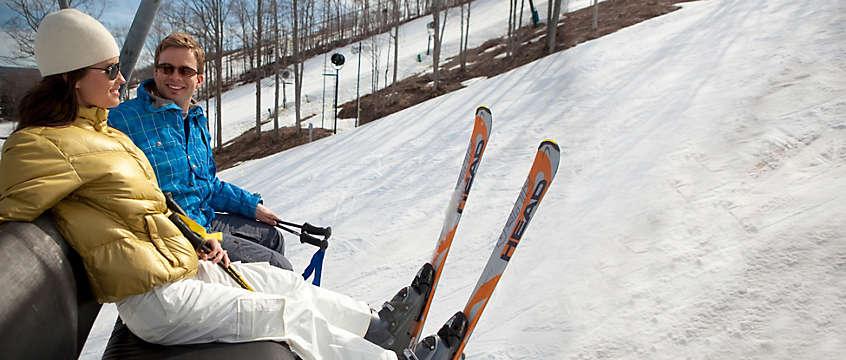 Couple on a ski lift in Boyne Falls, Michigan