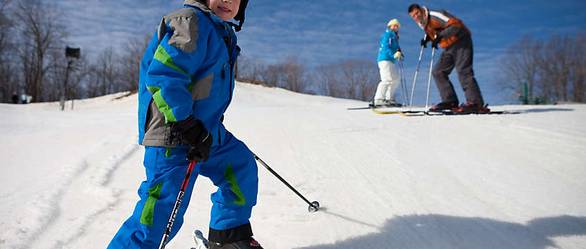 Family skiing on a winter vacation
