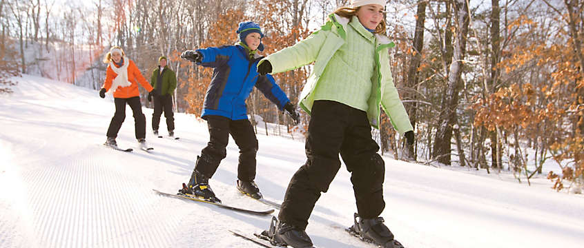 Kids skiing on winter vacation